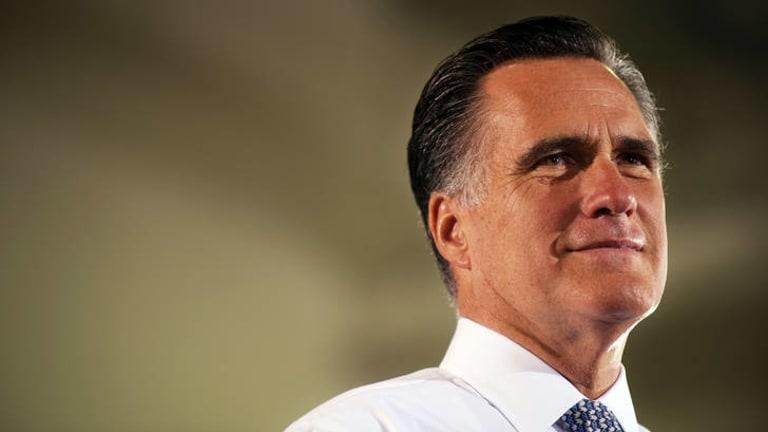 Under fire ... Mitt Romney.