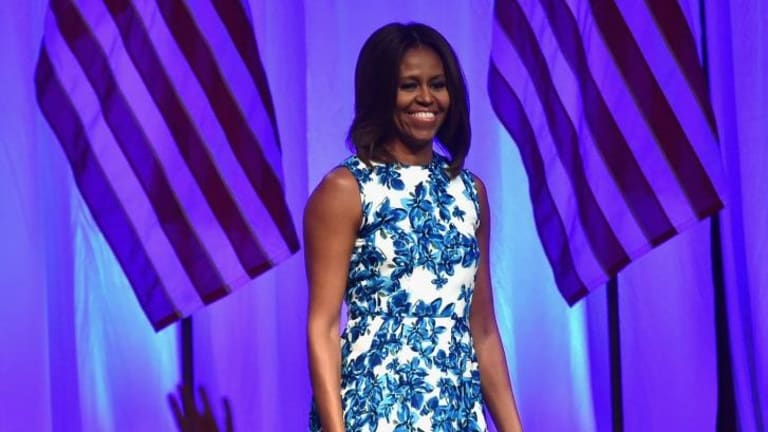 Role model: Michelle Obama is encouraging young Americans from low-income families to aspire to college educations.