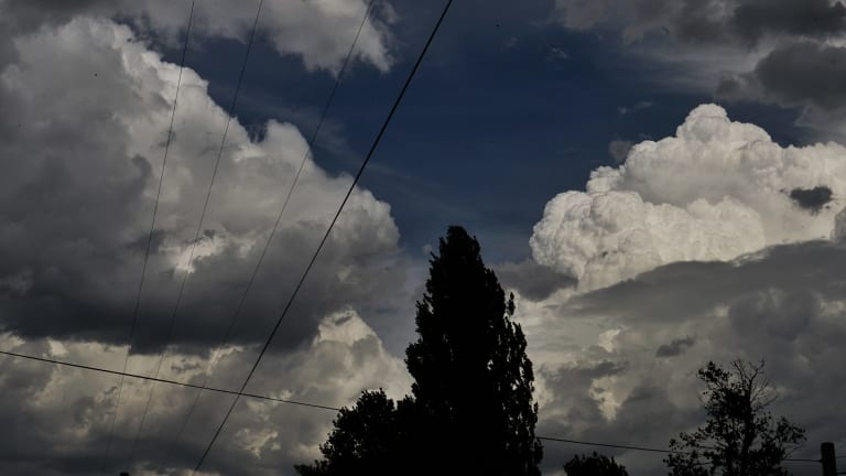 A patch of blue sky is visible as dark clouds move in.
