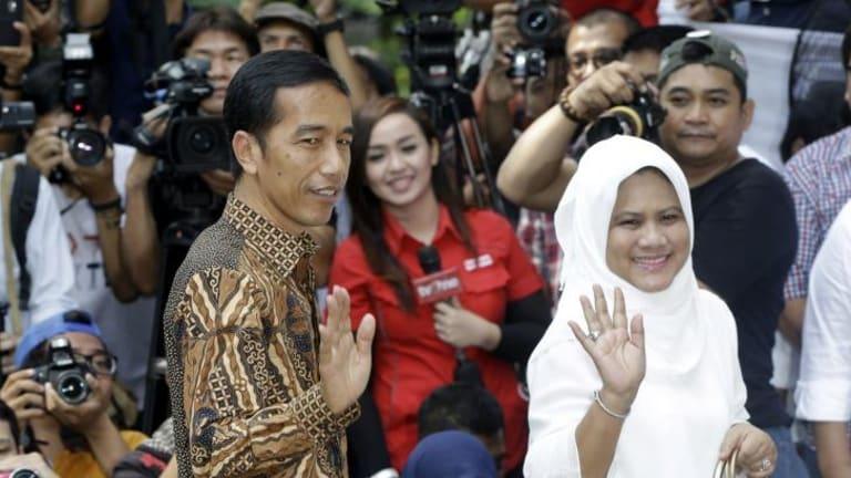 "Indonesian president-elect Joko Widodo, popularly known as ""Jokowi"", and his wife Iriana."