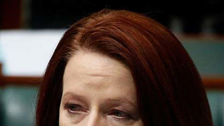 Emotional ... Julia Gillard addresses parliament on the human cost of the floods.