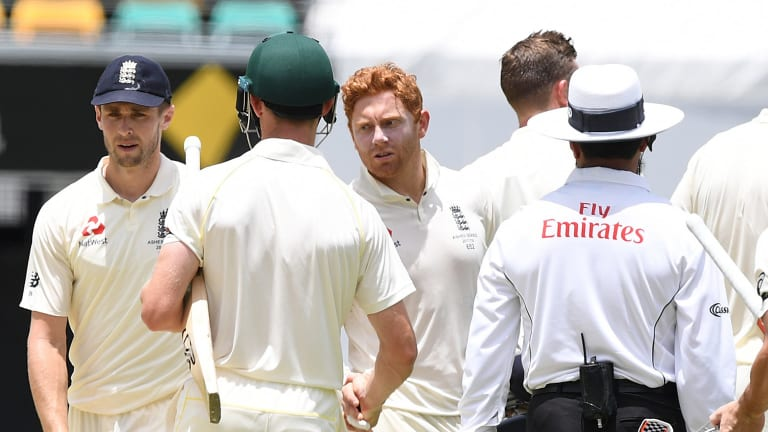 Jonny be good: Bairstow extends his hand instead of his head to Cameron Bancroft as Australia completes victory in the first Test on Monday.