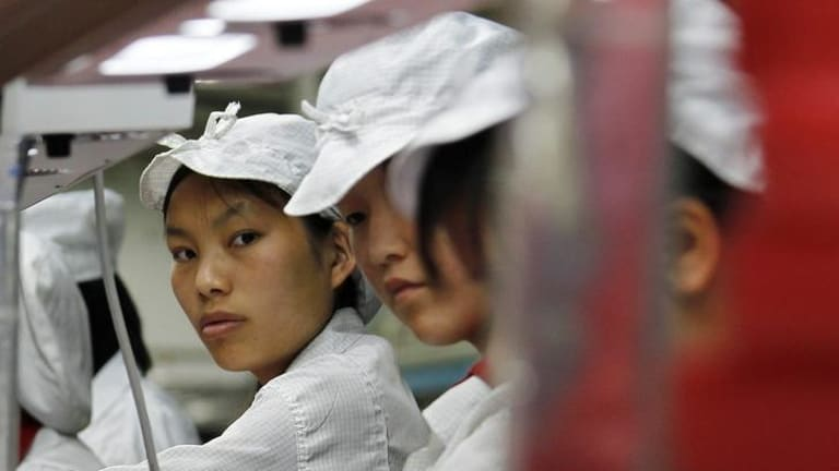 Workers are seen inside a Foxconn factory in the township of Longhua in the southern Guangdong province.