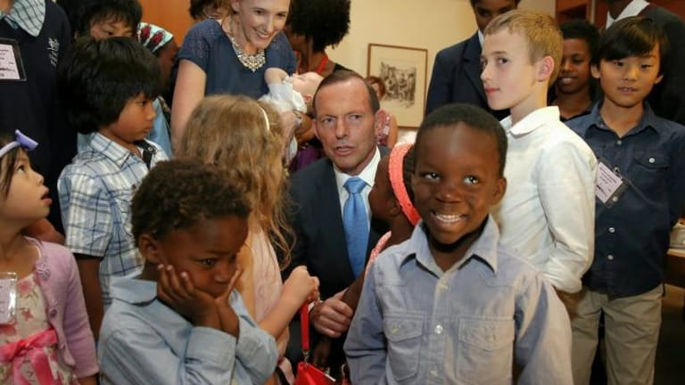 Prime Minister Tony Abbott meets with families during a morning tea ahead of Adoption Awareness Week.