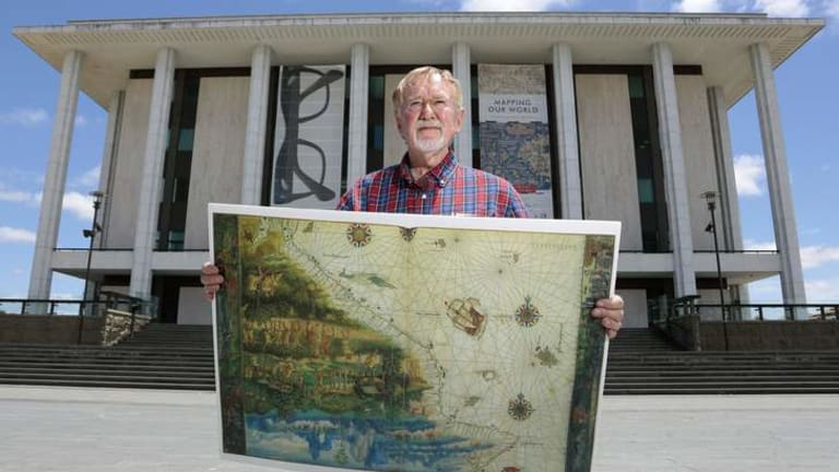 Historian and author Peter Trickett in front of the National Library of Australia with a replica of the map from the 1547 Vallard Atlas depicting the East Coast of Australia drawn 223 years before Captain Cook.
