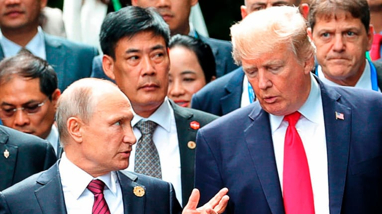 President Donald Trump and Russia President Vladimir Putin talk during the family photo session at the APEC Summit in Danang.