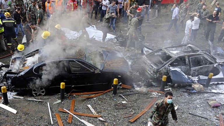 Beirut blast: Soldiers, policemen and medical personnel at the site of explosions near the Iranian embassy.