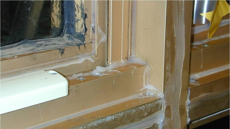 An attempt to seal a leaking window in a Melbourne apartment.