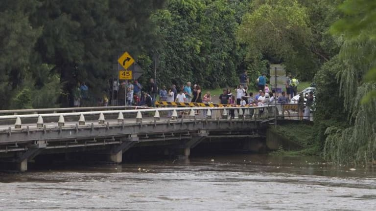 Onlookers in Windsor come to view the Hawkesbury River as it rises.