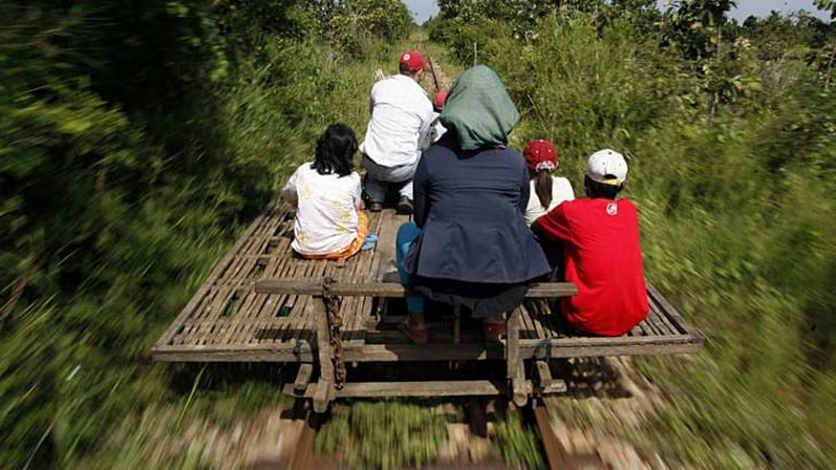 Link: Cambodians ride a bamboo train on a reopened stretch of line.