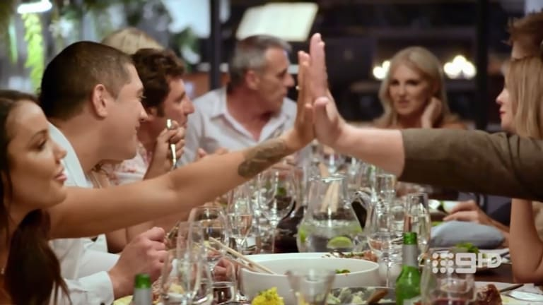 But soon turns to flirtation across the table, with Davina checking Dean's hand size.