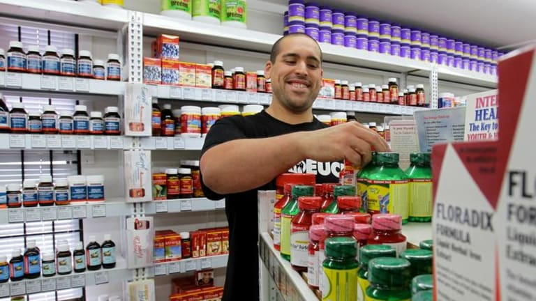 Nathan Meola lost over 100 kg and now works in a health shop.
