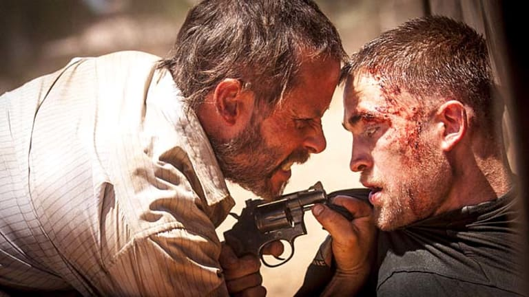 Strange and disturbing: Guy Pearce and Robert Pattinson in <em>The Rover</em>.