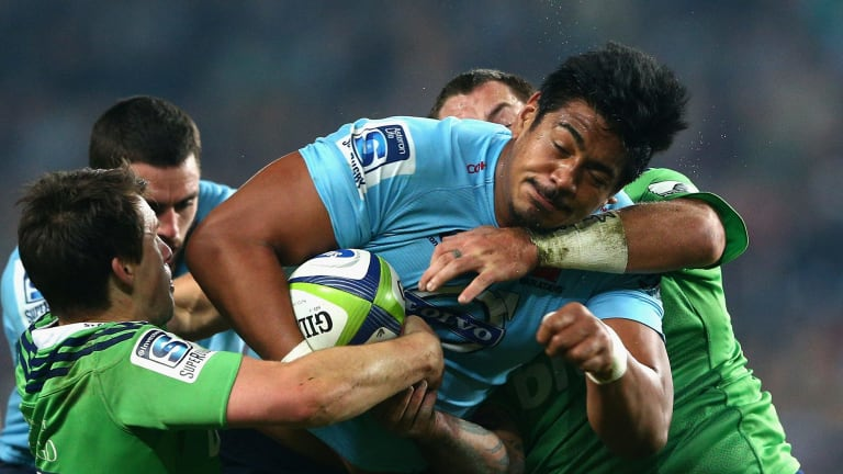 Will Skelton of the Waratahs is tackled during the Super Rugby semi final between the Waratahs and the Highlanders at Allianz Stadium.