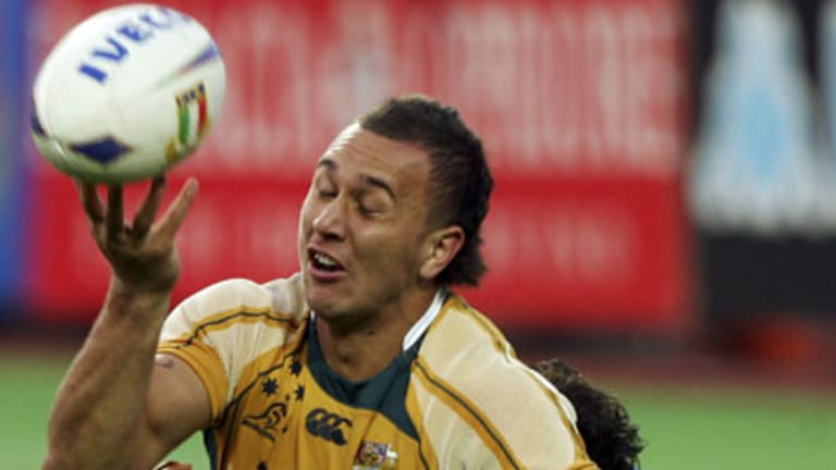 Quade Cooper juggles the ball during the clash against Italy in Canberra