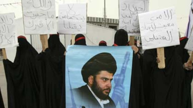 Anti-government protests ... Iraqi Shiite women with banners of the radical cleric Muqtada al-Sadr.