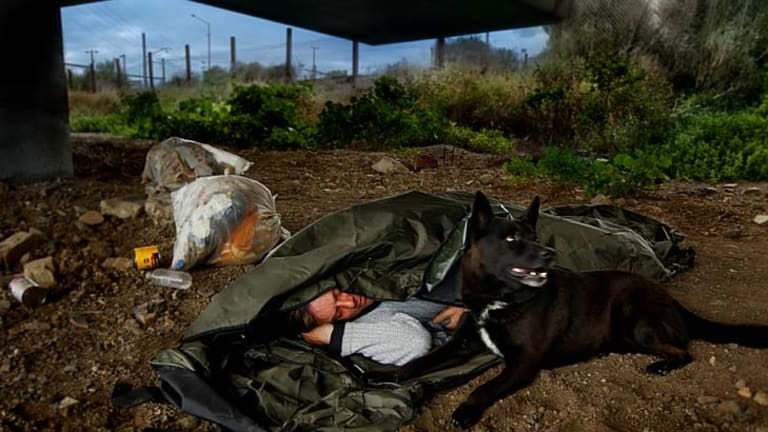 Simon, with his dog Bull, was sleeping rough under this City Link bridge when he was offered the backpack bed that he used for nine months.