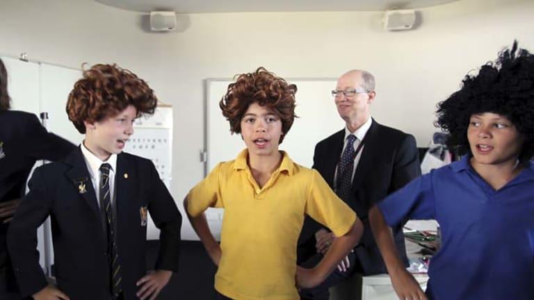 School drama ... John Colet year 6 pupils perform Shakespeare's The Comedy of Errors as headmaster Gilbert Mane looks on.