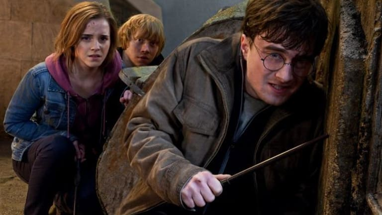 Danielle Radcliffe (right) as the boy wizard, with Emma Watson and Rupert Grint, in <i>Harry Potter and the Deathly Hallows: Part 2</i>.
