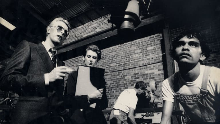 David Bowie runs through the script of Let's Dance in April 1983. Terry Roberts at right, figures in the video, towing a milling machine.
