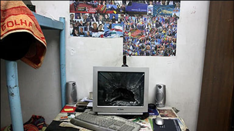 (Top) A broken computer monitor in a room in a Tehran University dormitory after it was attacked by militia forces during riots in Tehran on Monday and (bottom) the current website for the Iranian President Mahmoud Ahmadinejad.