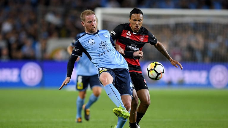 Fierce rivalry: David Carney competes for possession with Kearyn Baccus.
