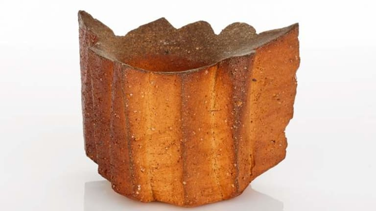 A red stoneware vase by Yasuhisa Kohyama.