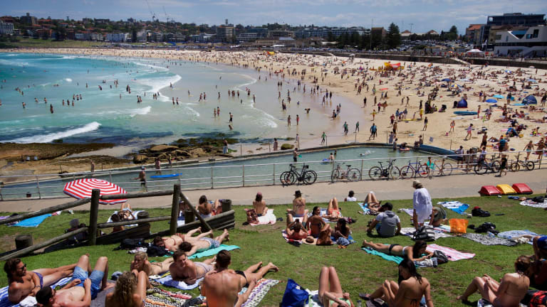 Sydneysiders enjoy the warmer weather at North Bondi earlier this month.