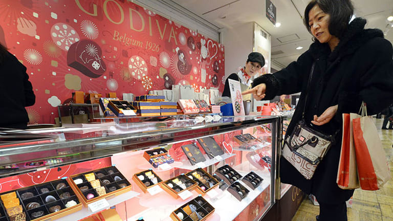 A Japanese woman buys chocolate from Belgian brand Godiva at Tokyo's Takashimaya department store.