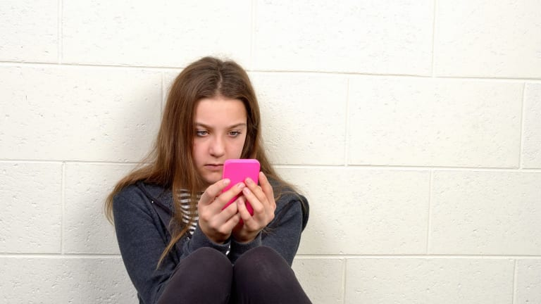 Australian schools are monitoring what students do on their mobile phones using technology that can also disable their cameras.