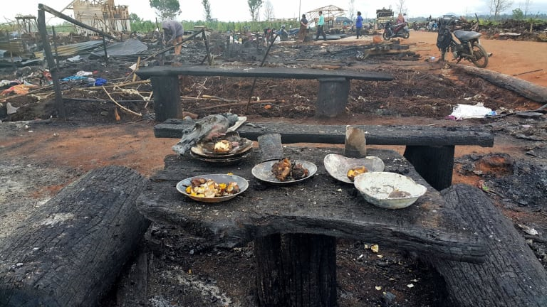 The charred remains of the Gafatar settlement burned down by a local mob.