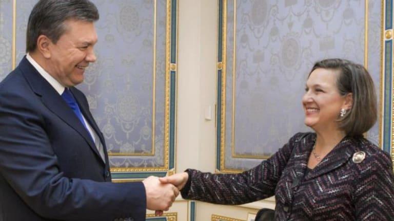 Ukraine's President Viktor Yanukovych, left, greets US Assistant Secretary for European and Eurasian Affairs Victoria Nuland  in Kiev.