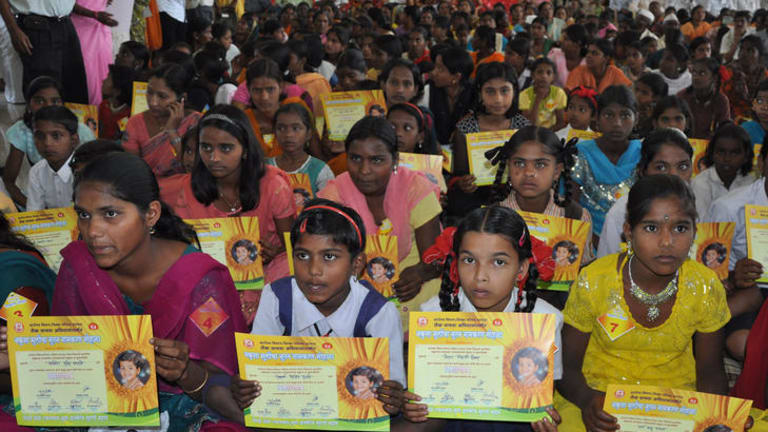 Indian girls hold up their name change certificates during a ceremony in Satara, 250 kilometres from Mumbai.