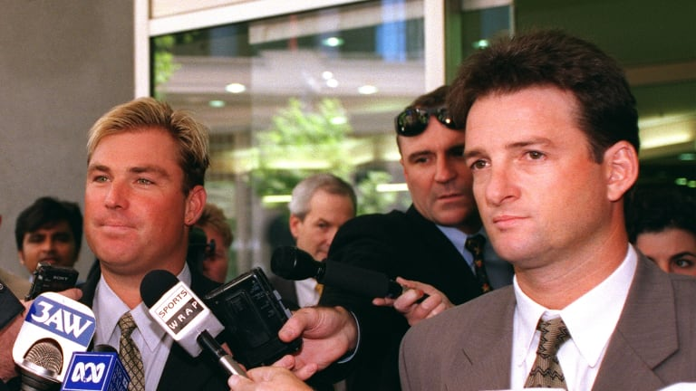 Australian cricketers Shane Warne and Mark Waugh were fined over their involvement with a bookmaker.
