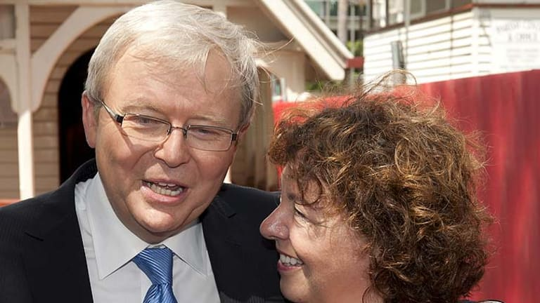 Kevin Rudd speaks to the media with his wife Therese Rein  outside of the Saint John the Babtist church in Bulimba on February 26, 2012.