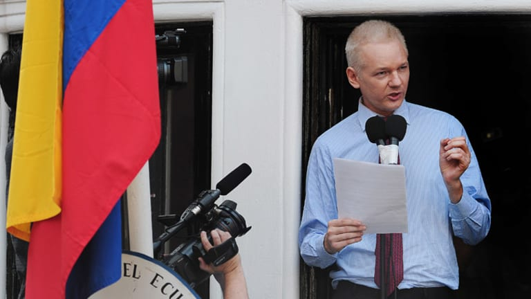 Julian Assange speaks at the Ecuadorean embassy in London earlier this year.