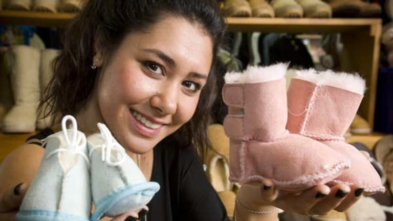 No excuse for cold feet ... Emma Howard displays baby ugg boots fit for Denmark's newborn royal twins in Hobart yesterday.