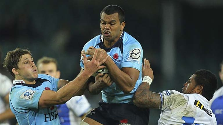 Waratahs fullback Kurtley Beale takes a high ball during the round 12 Super Rugby match against the Western Force.