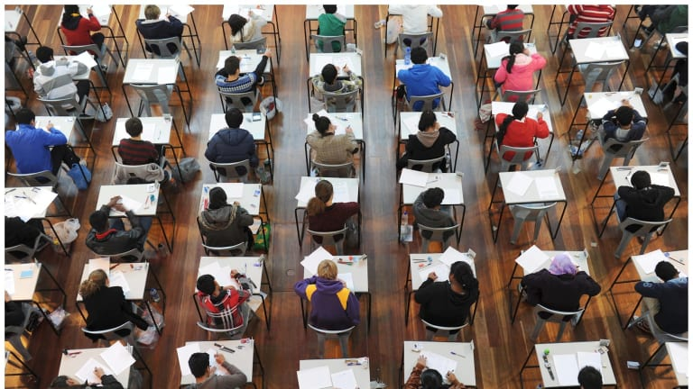 Students sitting exams for entrance to selective schools.