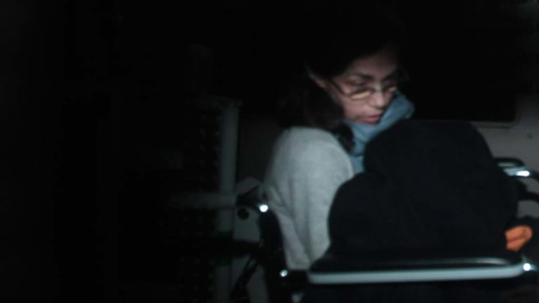 Nancy Kissel sits in a prison van as she arrives at the High Court in Hong Kong today