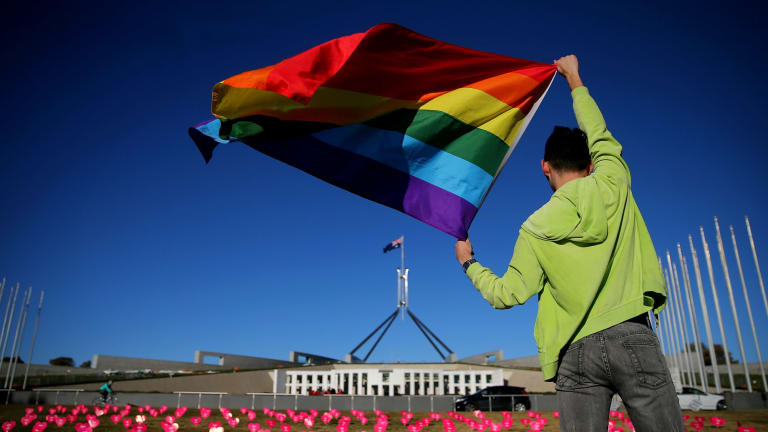 Marriage equality advocate Russell Nankervis with the rainbow flag during a 'Sea of Hearts' event in support of marriage equality at Parliament House earlier this month.