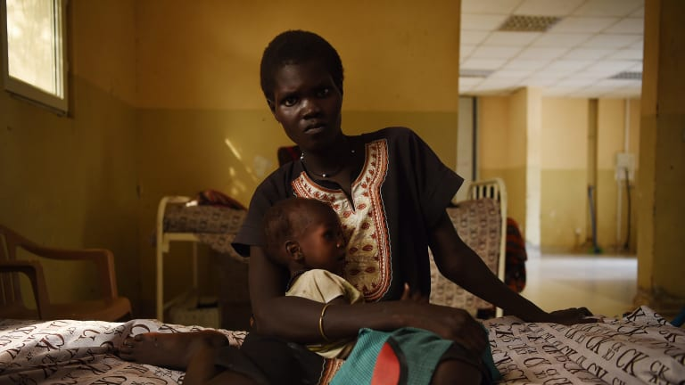 Nyereka Maliyah, 20, with her one-year-old baby Dictor Geng. Dictor is being treated at the CARE stabilisation point at Bentiu Hospital in South Sudan.