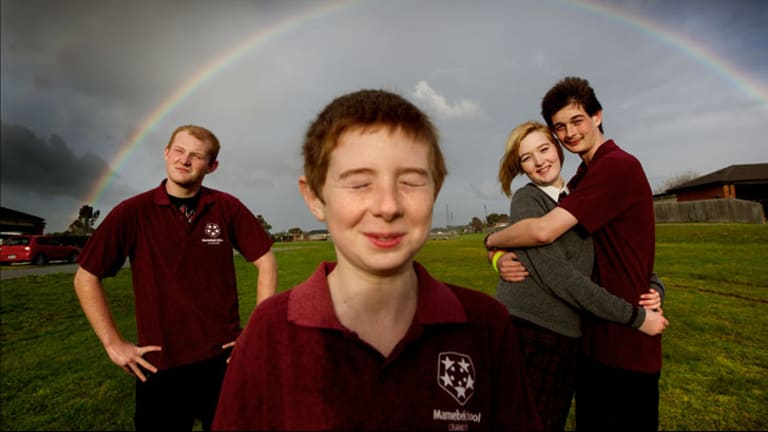 Charlotte Lampard, 16, helps care for her intellectually disabled brothers Jacob, 17, Ben, 11, and Lachlan, 14.