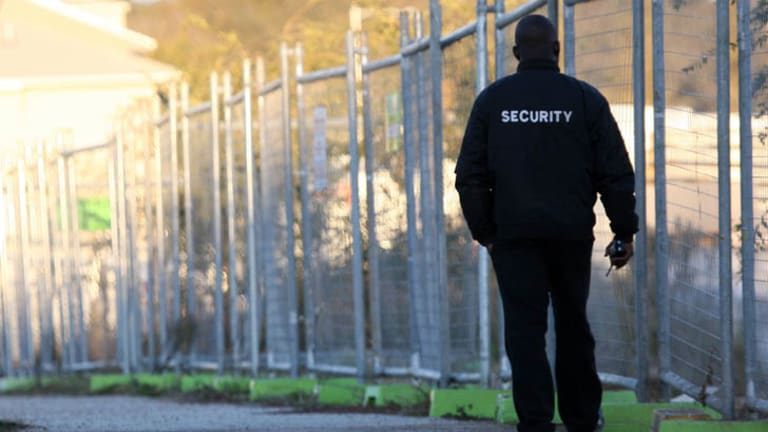 A security guard patrols a Canberra construction site.
