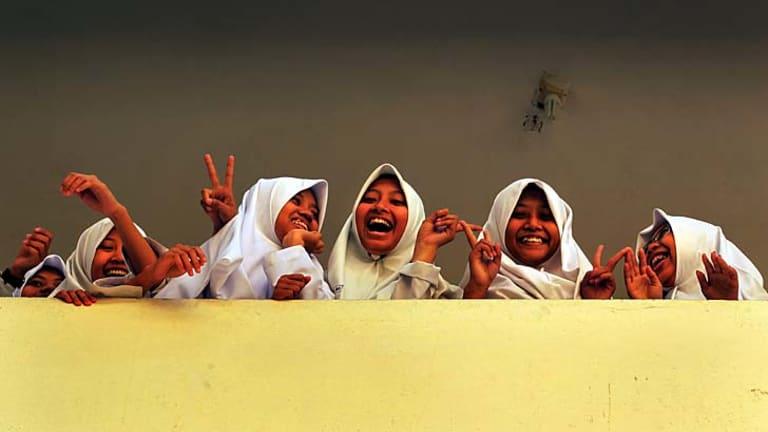 Students laugh during a break in classes at al-Mukmin school.