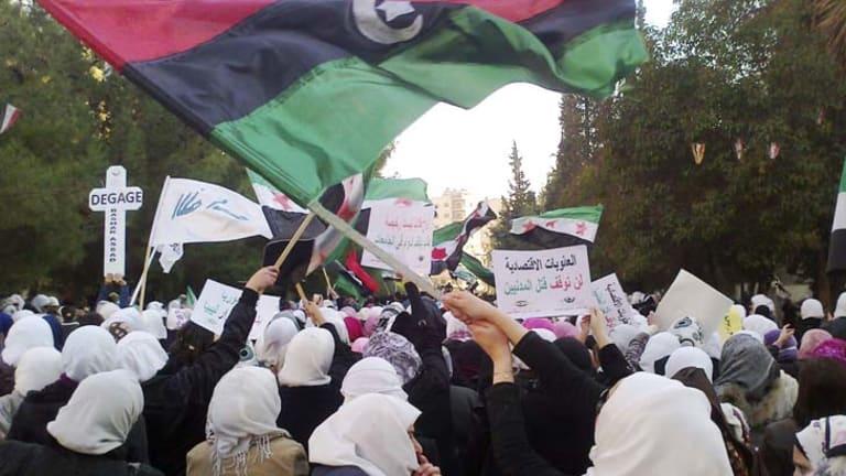 Surrounded ... demonstrators in Homs protest against the Bashar al-Assad regime.