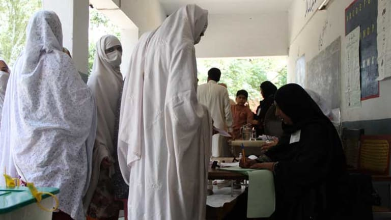 Rizwana, second from the front, looking at camera, lines up to vote in Pakistan's general election on Saturday. More women were registered to vote than in any previous poll in the country. But women were still disenfranchised. In conservative areas, clerics banned women from voting or threatened punishment for their families if they did. In Peshawar militants tried to kill women voters.