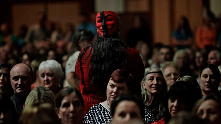 A woman turns her back on Opposition Leader Tony Abbott during his speech.