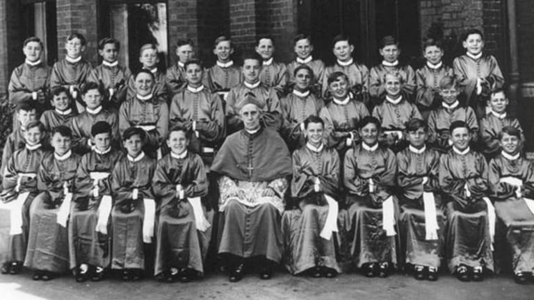 Vienna Mozart Boys Choir with Archbishop Mannix in 1939.