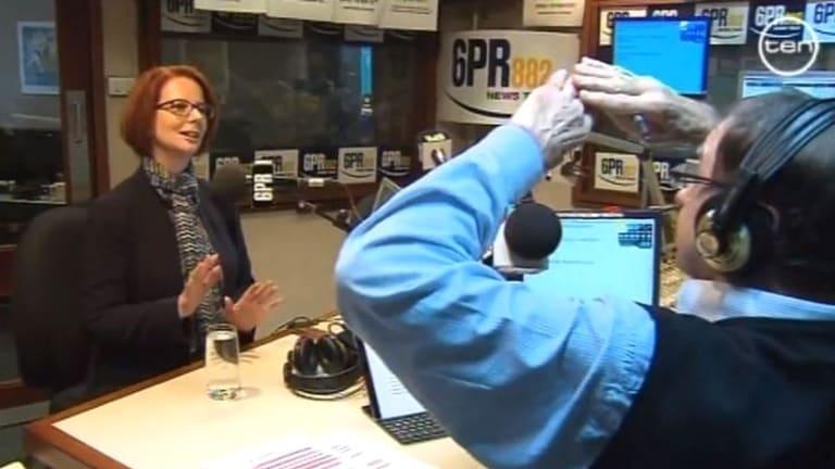 6PR host Howard Sattler interviewing Julia Gillard in the studio.